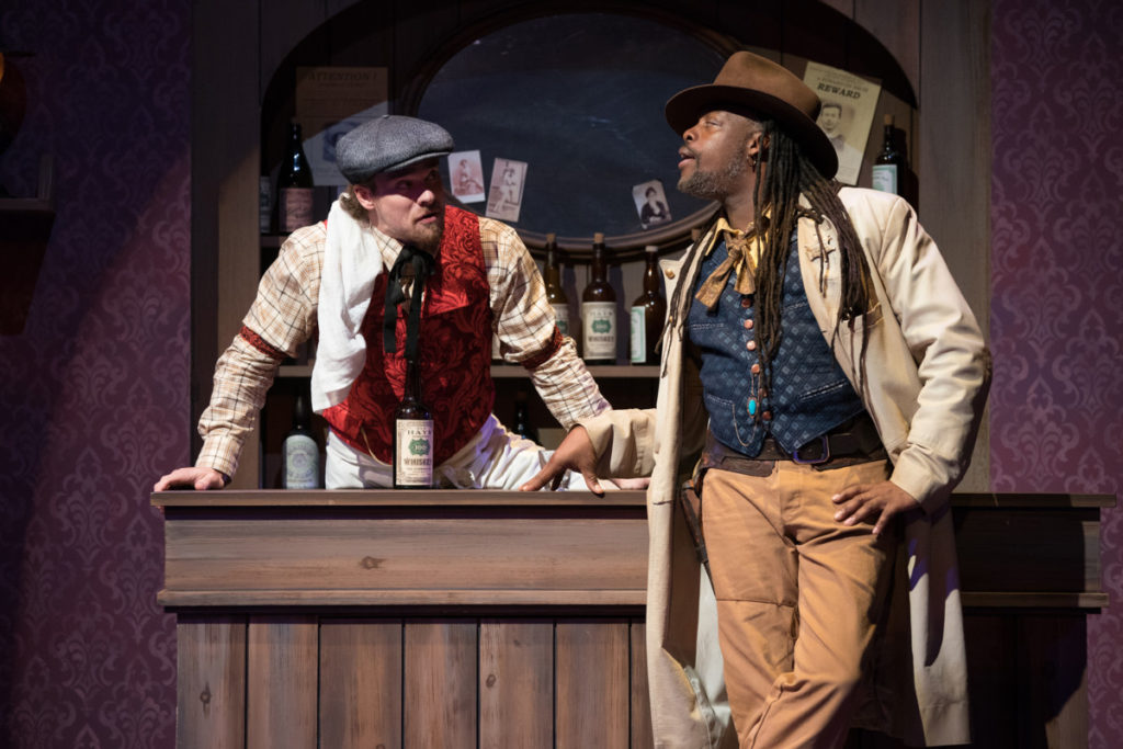 Pryor (Stephen Michael Spencer, left) and the Sheriff (Steven Sapp) catch up at the Stewed Prunes Saloon. Photo by Jenny Graham, Oregon Shakespeare Festival.