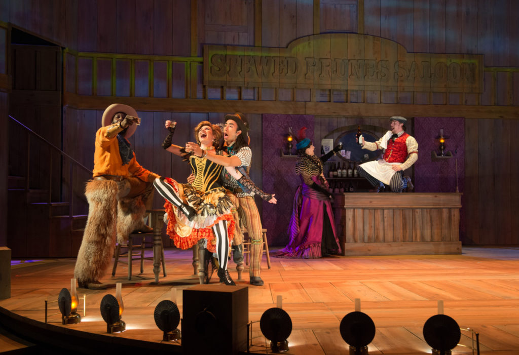 Cowboy (Cedric Lamar), Saloon Girl (Jen Olivares), Alexie (Román Zaragoza), Madame Overdone (Sheila Tousey) and Pryor (Stephen Michael Spencer) live it up at the Stewed Prunes Saloon. Photo by Jenny Graham, Oregon Shakespeare Festival.