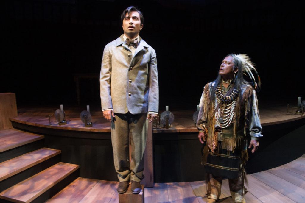 Momaday (Shaun Taylor-Corbett) is visited by the spirit of his Grandfather (Brent Florendo). Photo by Jenny Graham, Oregon Shakespeare Festival.