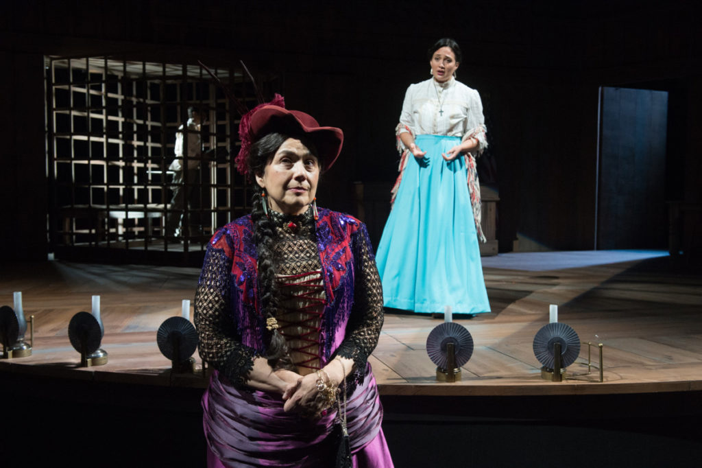 Madame Overdone (Sheila Tousey) hatches a plan to free Isabel (Lily Gladstone) and Momaday (Shaun Taylor-Corbett) from Angelo's treachery. Photo by Jenny Graham, Oregon Shakespeare Festival.