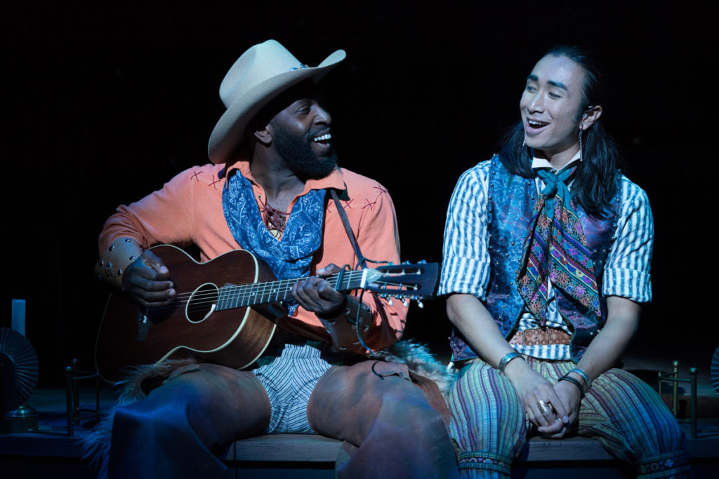 Cowboy (Cedric Lamar) and Alexie (Román Zaragoza) sing of their feelings for each other and their misgivings about what's happening in town. Photo by Jenny Graham, Oregon Shakespeare Festival.