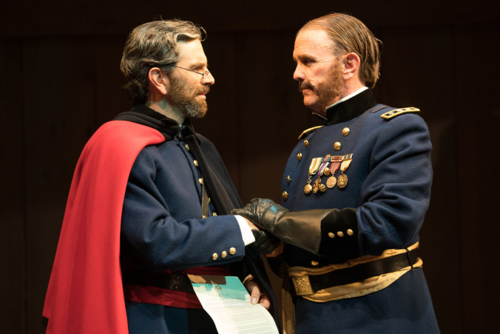 General Gatt (David Kelly, right) charges Angelo (Barret O'Brien) with the town's governance in his absence. Photo by Jenny Graham, Oregon Shakespeare Festival.