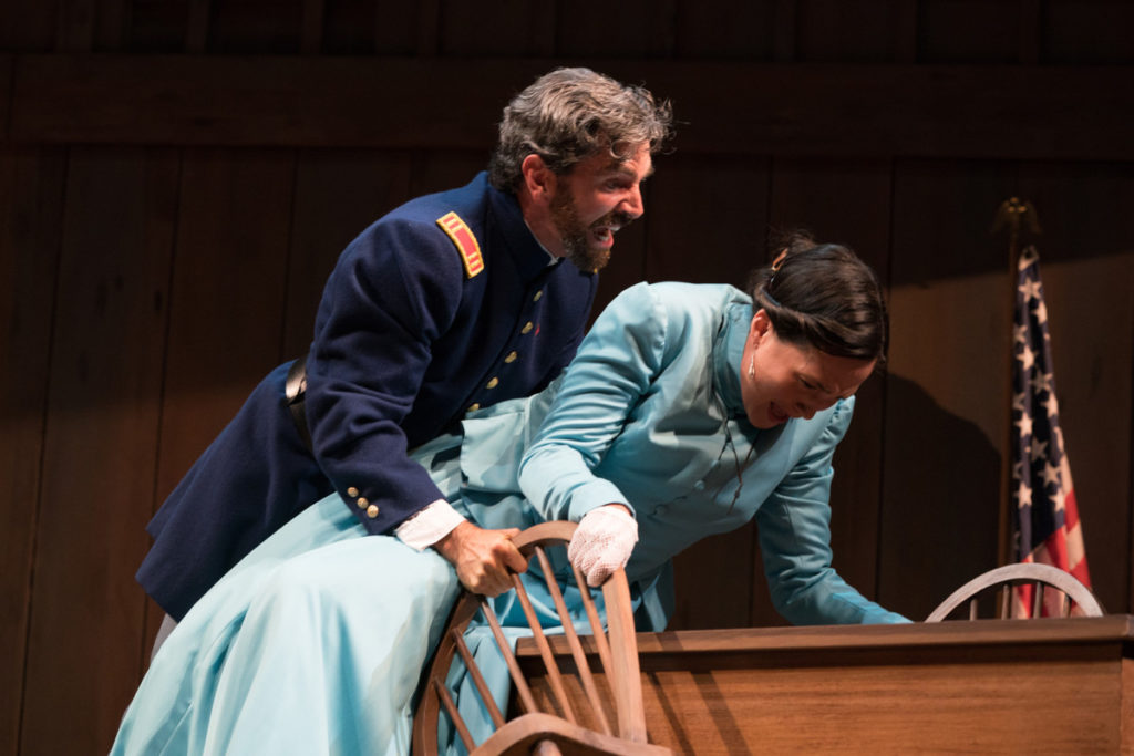 Angelo (Barret O'Brien) makes his foul intentions for Isabel (Lily Gladstone) abundantly clear. Photo by Jenny Graham, Oregon Shakespeare Festival.